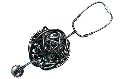 A stethoscope with the middle all rolled up into a big jumbled ball