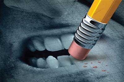 Drawing of an angry looking mouth be erased by a pencil eraser