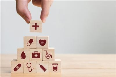 Building blocks with health-related icons on them