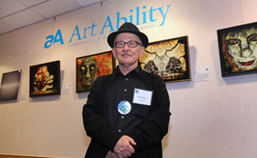 Max Tzinman poses with his works, including the 2015 Art Ability featured piece, Unfocused 2