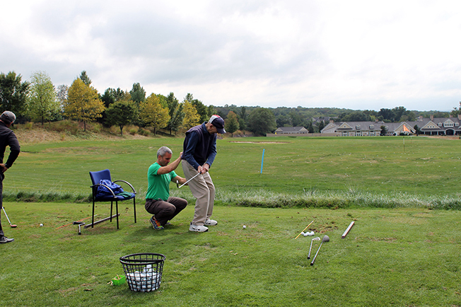 First Swing 2016 attendee golfing with assistance