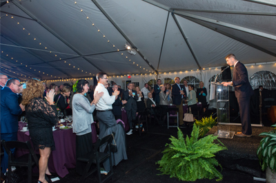 Keynote speaker, Blake Emerson, engages the crowd at the Art Ability preview reception dinner and auction