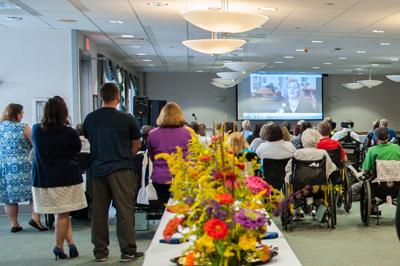Patients, employees and family members listen intently to the stories of recovery shared by four former Bryn Mawr Rehab patients