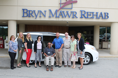 A group of people posing with the new Sienna van from Team Toyota of Glen Mills