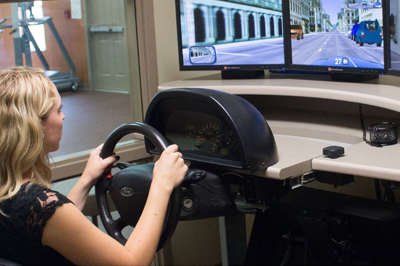Person using driving simulator