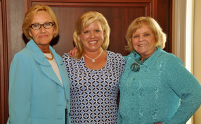(Left to right) Incoming Paoli Hospital Auxiliary president Carol Rabe Palmer, past president Lisa Ferrie-Kennedy and outgoing president Denise Degus