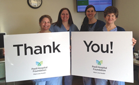 caregivers holding thank you sign