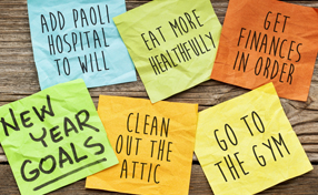 Post-It notes about new year goals including adding Paoli Hospital to your will