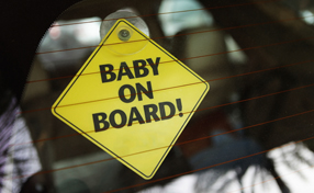 baby on board sign in car back window