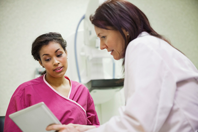 Technician with mammogram patient going over information
