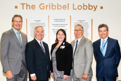 Leadership at Riddle Hospital, Main Line Health, posing for a photo in the newly christened Griddle Lobby