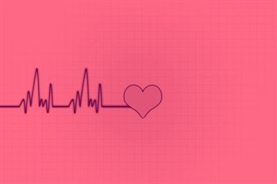 EKG leading to heart drawing on pink background