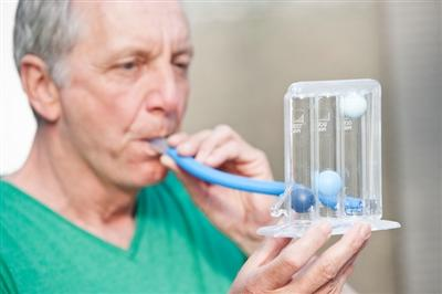 Man performing lung capacity test