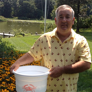 Jack Lynch holding a bucket for #IceBucketChallenge