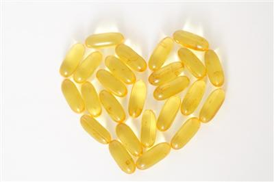 Oil capsule vitamins arranged in a heart shape