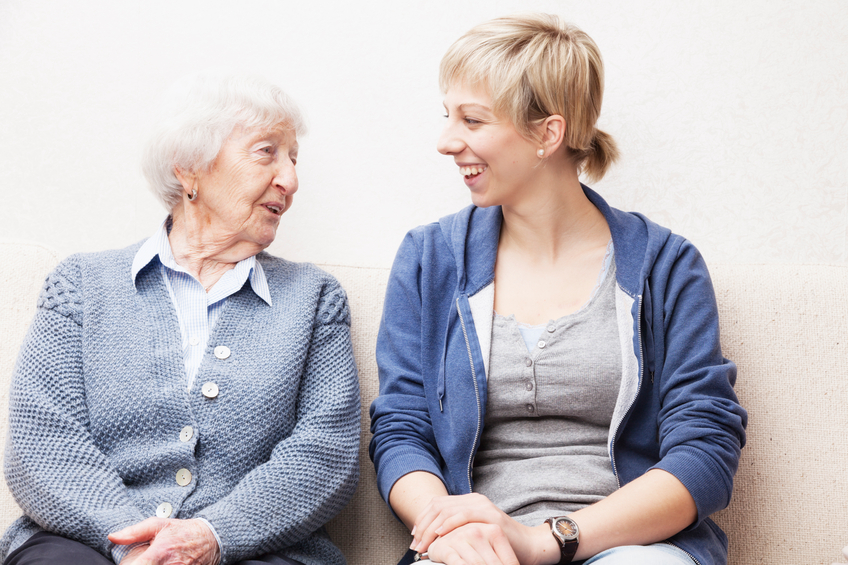 aging woman and her female caregiver