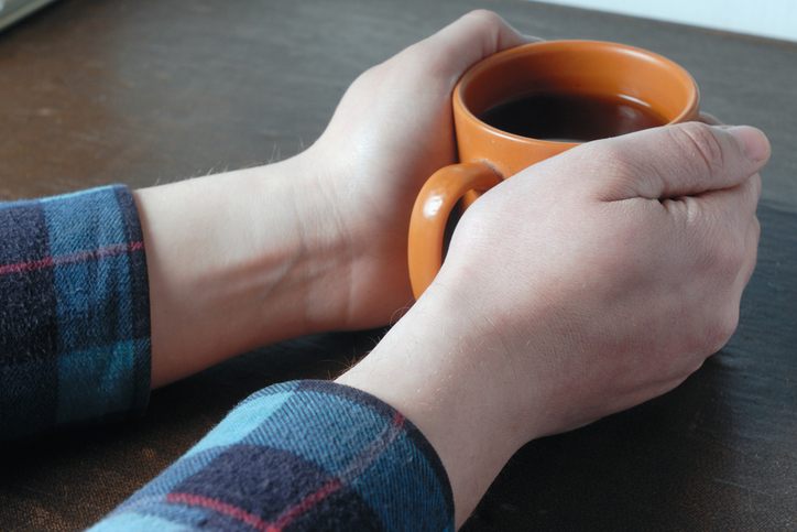 Hands around cup