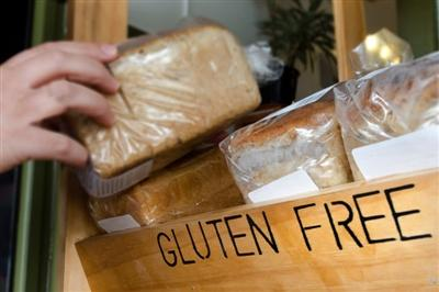 Gluten-free sign and bread shelf