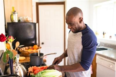Man cooking with fresh ingredients in the kitchen