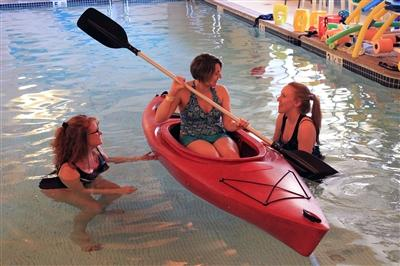 Therapists with patient in kayak