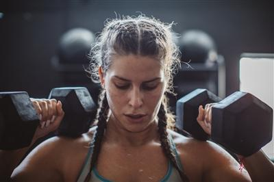 Woman working out with arm weights