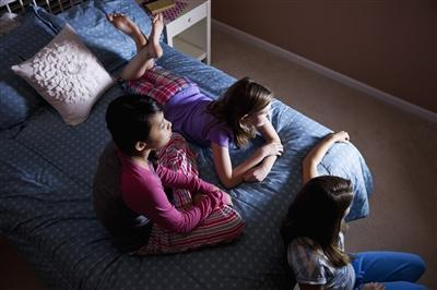 Group of teens watching TV late at night