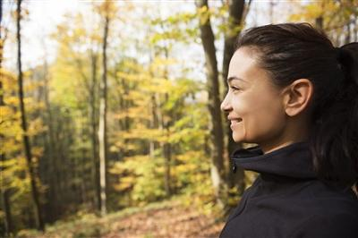 Woman looking happy during autumn