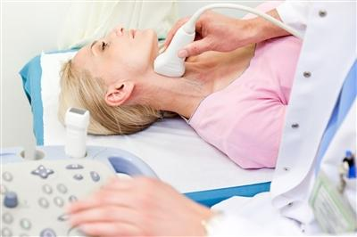 Woman getting carotid artery ultrasound