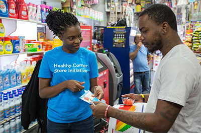 Person working at Healthy Corner Store program