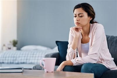 Woman sitting alone and looking stressed