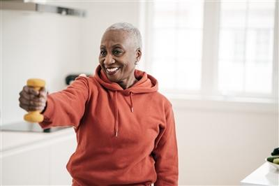 Senior women taking care of herself she exercise with dumbbells at home