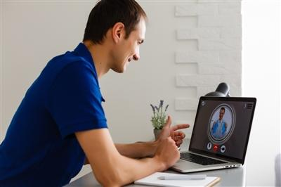 Man having video chat with doctor at home