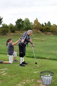 """Golfers received instruction and support on the driving range and putting green"""