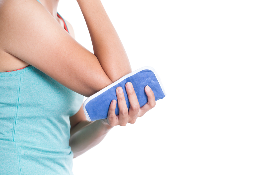 woman holding ice pad to elbow