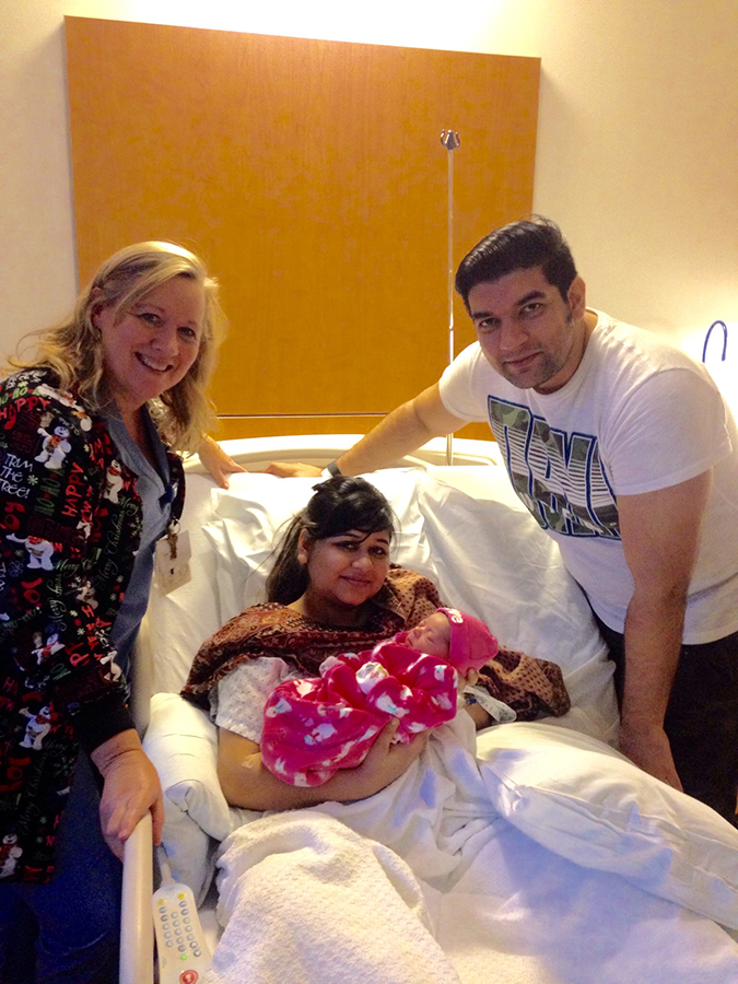 baby Irina with her parents Lagan and Mayank and with nurse Patti Conway