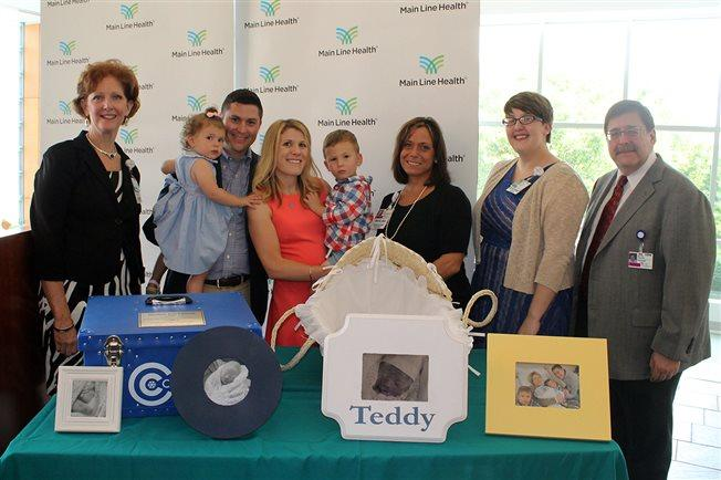 (Left to right) Margie Iacobacci, vice president of patient services at Lankenau Medical Center; the Clement family (their daughter Grace, who is 2, Chris and Beth Clement, and their son Henry, who is 3); Lynne Menei, nurse manager of the Lankenau Labor and Delivery Unit; Casey Bien-Aime, Lankenau Medical Center chaplain; and Dr. Norman Brest, Lankenau Medical Center campus chief of the department of OB/GYN