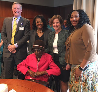 At the reception with Mamie Peace (seated) are Thomas Jefferson University Hospital President Rich Webster and Peace's daughters Lynn Peace, Esq. and Carmella Holloway flanking Andi Gilbert.