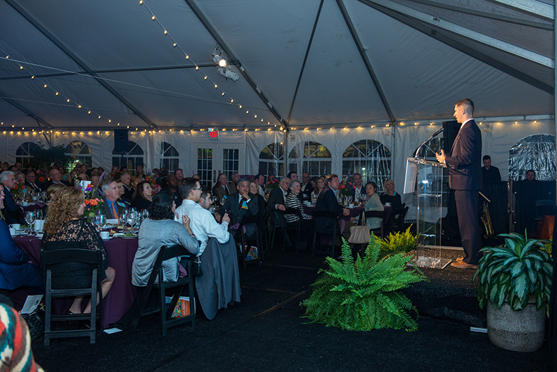 Keynote speaker, Blake Emerson, engages the crowd at the dinner and auction