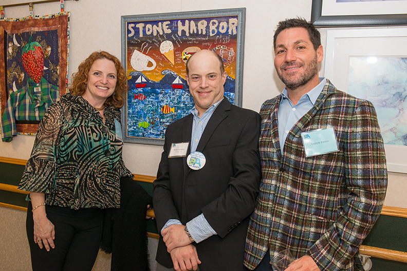 Foundation Board member Patty Panzo and husband Andrew Panzo with artist Michael Hungarter, creator of Panzo's newly acquired mixed media work, Stone Harbor
