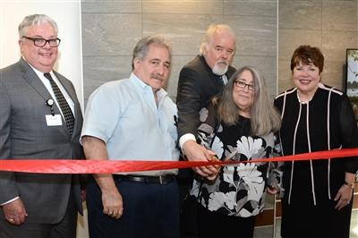 Members of the Birnhak Family, (second from left) John Birnhak with sister Valerie Birnhak and Chris Darling, join Phillip Robinson, president, Lankenau Medical Center, and Carol A. Irvine, Abramson president and CEO, to officially open the Birnhak Transitional Care Center at Lankenau Medical Center.