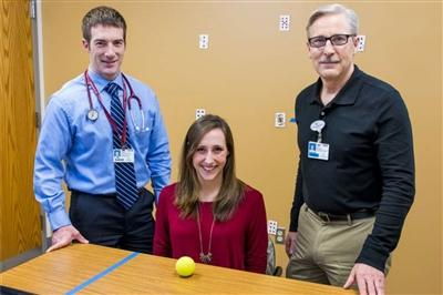 Kaylyn Sawyer with Dr. Brian McDonald (left) and therapist Clint Beckley (right)