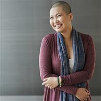 woman with shaved head smiling