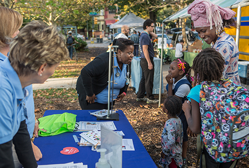 Community members at a Food Trust co-op event at Clark Park