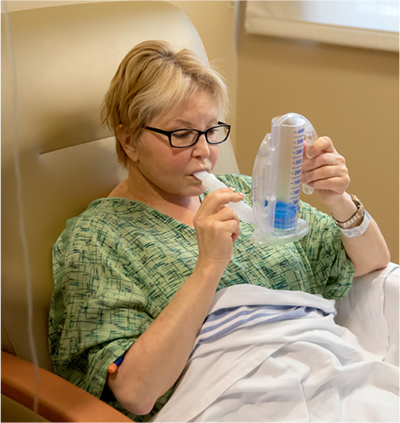 Patient using incentive spirometer