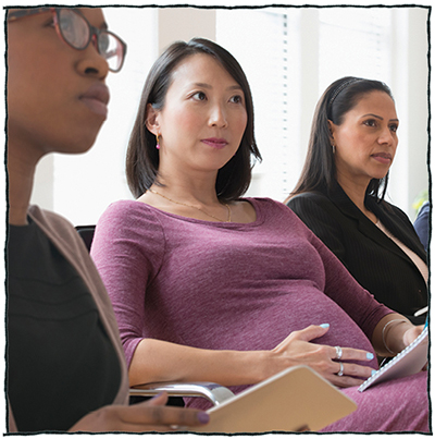 Pregnant women sitting in class