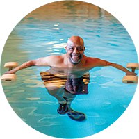 Patient using weights for aquatic therapy in the Bryn Mawr Rehab Hospital pool