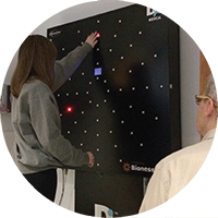 Patient using the Dynavision interactive LED light board at Bryn Mawr Rehab Hospital