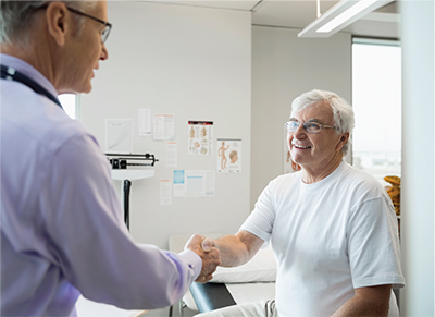 Man shaking hand with health care provider in a health care office