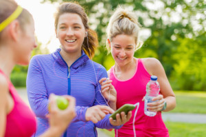 happy young women outside getting ready to exercise